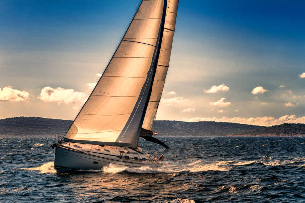 Front view of sailing boat agains the sunlight